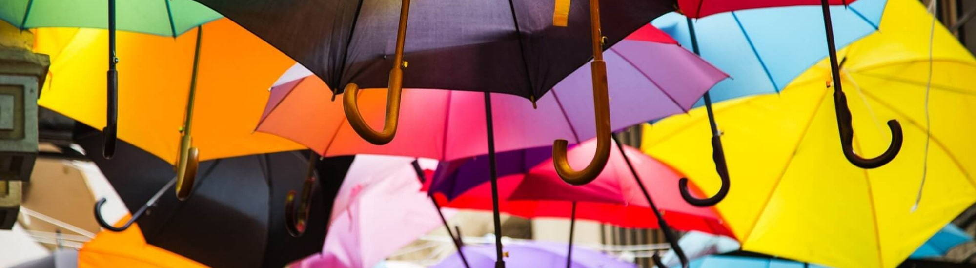 Colourful Umbrellas Suspended in the Air