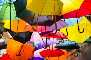 Many Colourful Umbrella Suspended in the Air